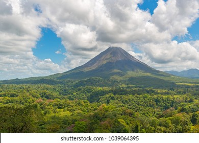 Complete landscape of the tropical rainforest and its canopy of the active Arenal volcano on a summer day near La Fortuna, Costa Rica, Central America.