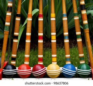 Complete set of croquet mallets and balls on grass
