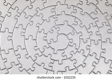 complete silver jigsaw - solarization - pieces fitting together in form of a spiral