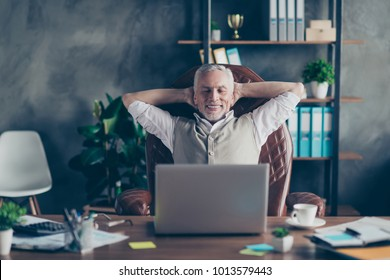 Complete task holidays fantasy rich luxury glad fun time-out concept. Cheerful positive excited careless peaceful virile banker keeping hands behind head closed eyes sitting modern light workstation