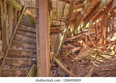 A complete and total interior structural failure, of an abandoned house.