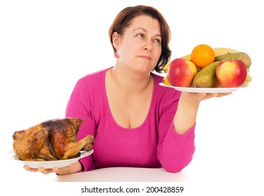 A complete woman is the choice of what to eat chicken or fruit, isolated on white background