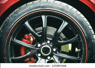 Completed in a high quality gloss. Black rim of luxury car wheel. Car wheel detail. Alloy wheel. Wheel and rim. Front or rear. Contemporary multi spoke design. Great modern styling.