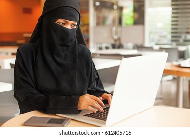 completely covered muslim woman working in office