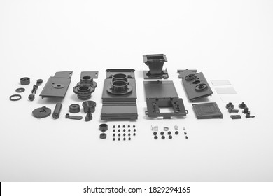 A completely deconstructed knolling style view of a vintage twin-lens camera on white background