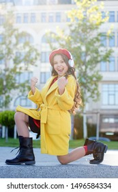 completely successful. music lover. new technology. happy parisian girl in french beret. autumn fashion. fall season. small girl child listen audio book. small girl dance in headset. online education.