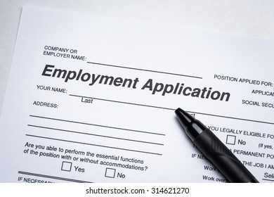 Completing an job application form with focus on heading