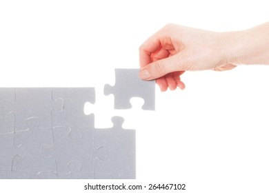Completing the last piece of jigsaw puzzle. Isoalted on white. Search for the solution, solving the problem, answer, business connection concept.