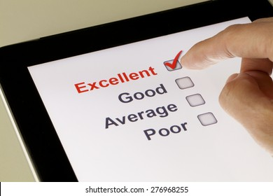 Completing online survey on a tablet, clicking excellent