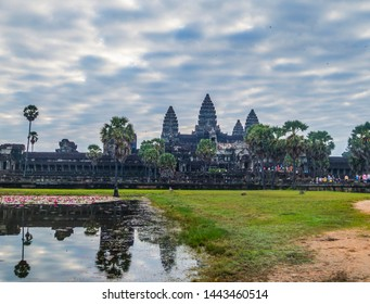 Complex of the ancient khmer temples of Angkor Wat  in Cambodia reflecting in water