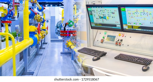 Complex gas distribution station equipment. Yellow pipes and control panel at the enterprise. Remote monitoring of machines. Workplace of the engineer on duty.