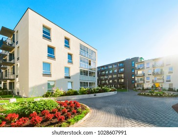 Complex of modern apartment residential buildings with flower plants and other outdoor facilities. Toned