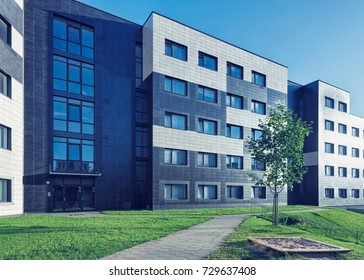 Complex of modern residential building with children playground as outdoor facilities.
