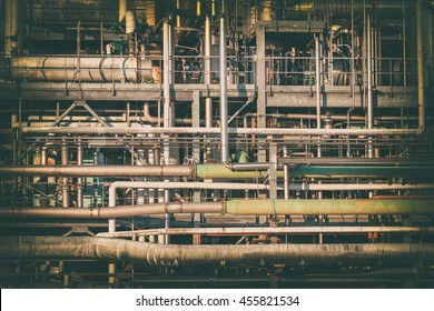 complex network of pipes in a factory filtered image