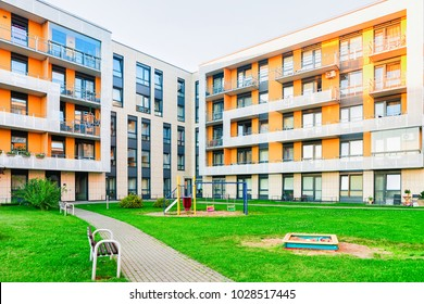 Complex of new apartment residential building with children playground as other outdoor facilities. Toned