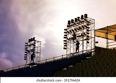 A complex scaffold setup for a stage for an outdoor concert.