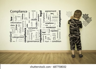 compliance concept. Photo for your design. The boy at the wall