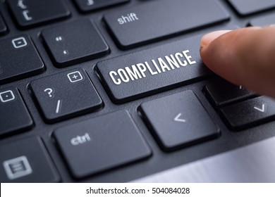 Compliance, finger on modern keyboard, business concept