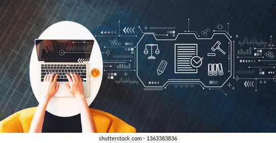 Compliance theme with person using a laptop on a white table