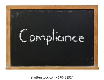 Compliance written in white chalk on a black chalkboard isolated on white