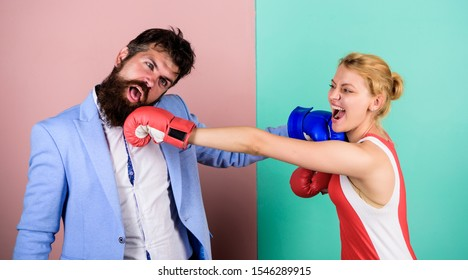 Complicated relationships. Difficult relationships. Couple in love competing boxing. Couple romantic relationships. Man and woman boxing fight. Boxers fighting gloves. Conflict concept. Family life.