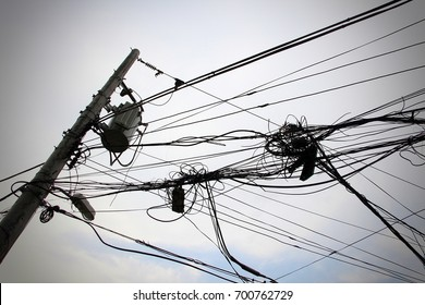 Complicated wiring connected to a transformer in an electricity post. Image Vignetted.