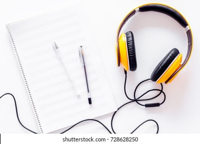 Compose music. Headphones and music notes on white background top view