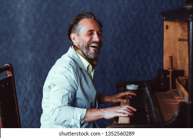 Composer Playing the Old Piano. He Plays An Amusing Composition. The Man Has a Good Mood He Laughs.