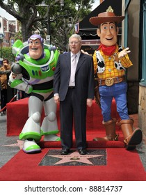 Composer Randy Newman with Toy Story 3 stars Buzz Lightyear and Woody was honored today with a star on the Hollywood Walk of Fame. June 2, 2010  Los Angeles, CA Picture: Paul Smith / Featureflash
