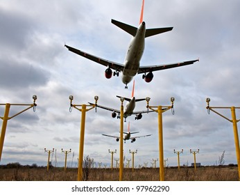 Composite of 3 airplanes landing close together, to depict crowded skies
