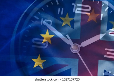 Composite of the EU and British flags with a clock conceptual of Brexit and the departure of Britain from the European Union, full frame background view
