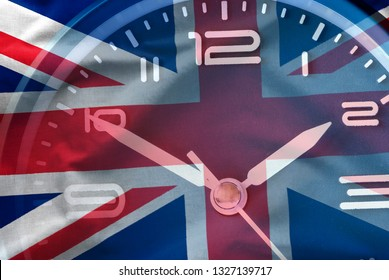 Composite image of the British flag and a clock face in a conceptual image of the countdown to Brexit when Britain leaves the EU