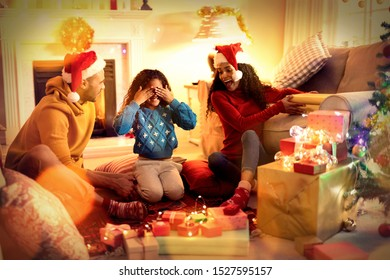 Composite image of brown parquet against family at home at christmas time