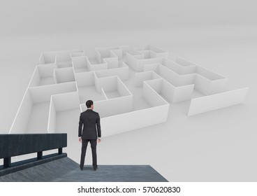 Composite image of business man on balcony looking at maze
