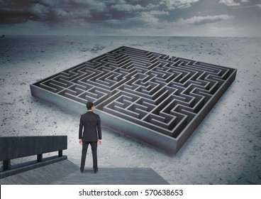 Composite image of businessman looking over maze