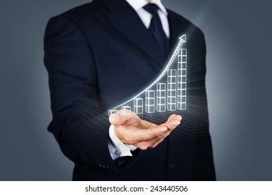 Composite image of a businessman with a rising chart in wireframe mode