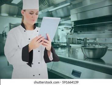 Composite image of chef using digital tablet in commercial kitchen
