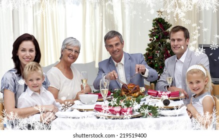 Composite image of a Family eating turkey in Christmas Eve Dinner against frost