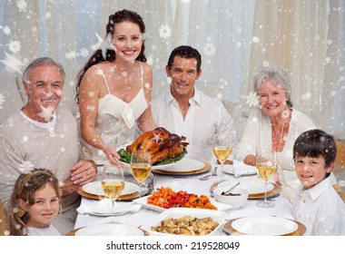 Composite image of Family eating turkey in a dinner against snow