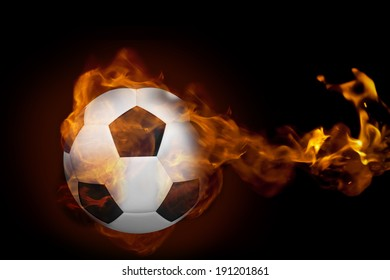 Composite image of fire surrounding football against black