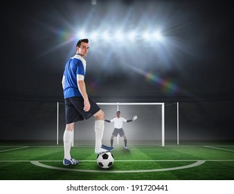 Composite image of football player about to take a penalty against football pitch under spotlights