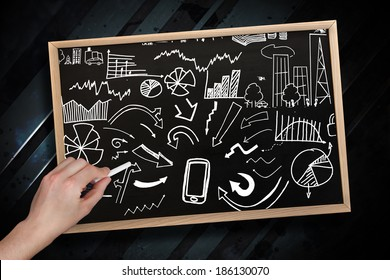 Composite image of hand drawing brainstorm with chalk on chalkboard with wooden frame