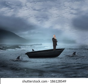 Composite image of happy businessman looking away in a sailboat being circled by sharks