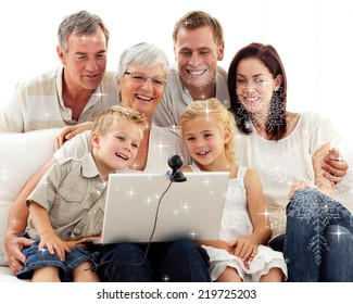 Composite image of happy family in a video conference against snow