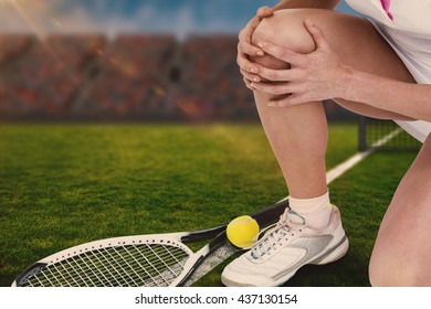Composite image of injured tennis player against a stadium