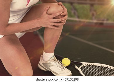 Composite image of injured tennis player against tennis field