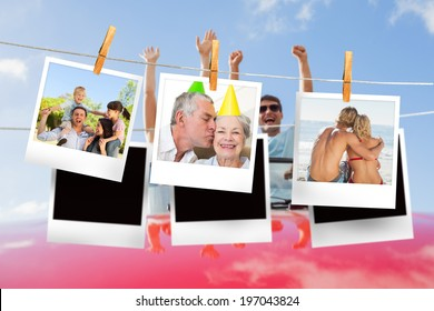 Composite image of instant photos hanging on a line against cheering couple in convertible