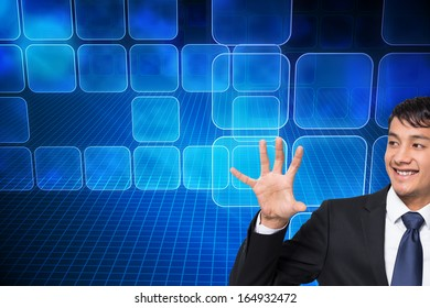 Composite image of smiling businessman holding and pointing