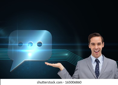 Composite image of smiling businessman presenting something with his hands