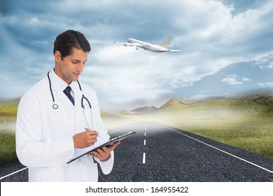 Composite image of smiling doctor holding pen and clipboard